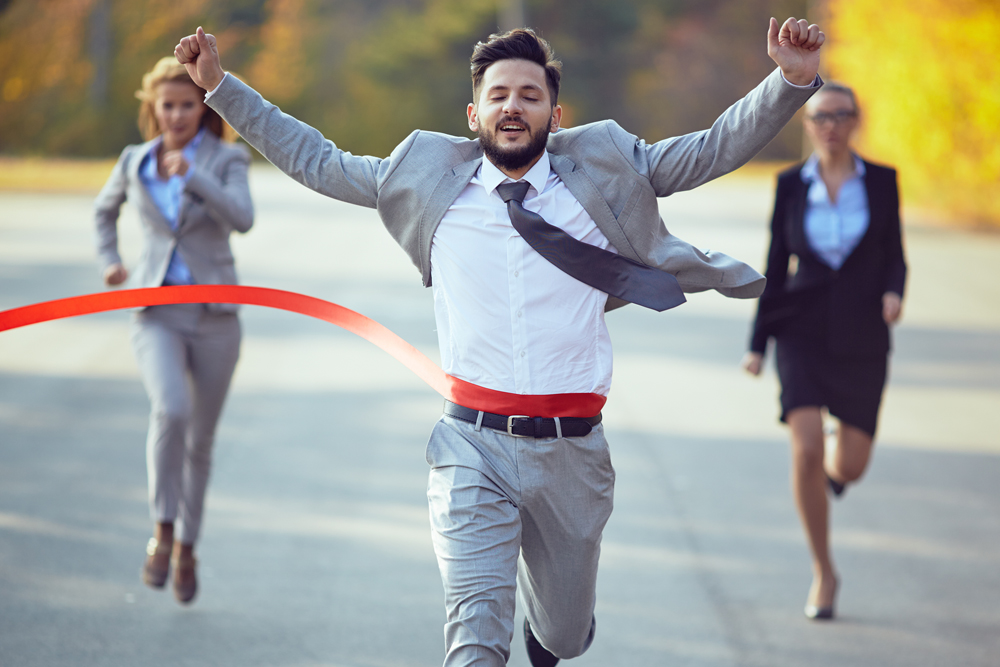 man in suit finishing the race
