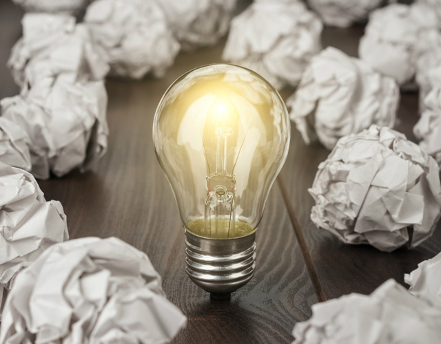 light bulb and crampled papers