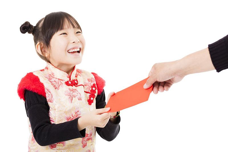 chinese kid getting a red envelope